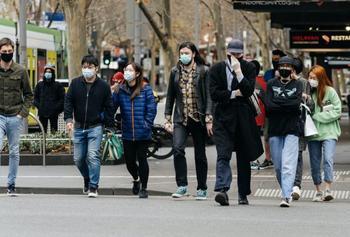 People walking down the street.