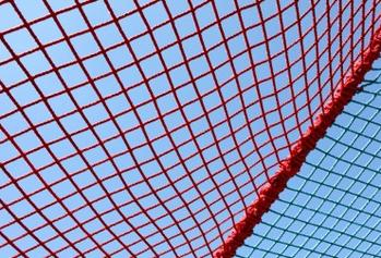 Image of a safety net against a blue sky